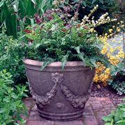 vaso da giardino in pietra