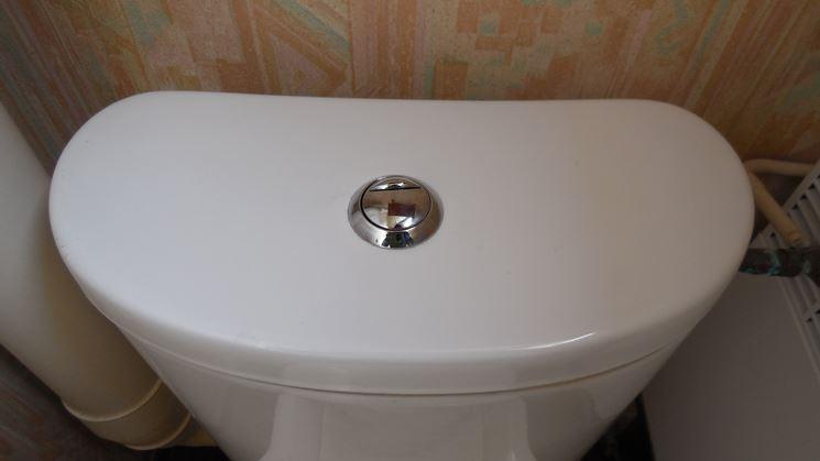 Cassetta con bottone per lo scarico del wc