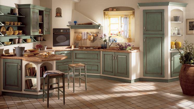 Cucina rustica in muratura con intonaco e inserti in legno
