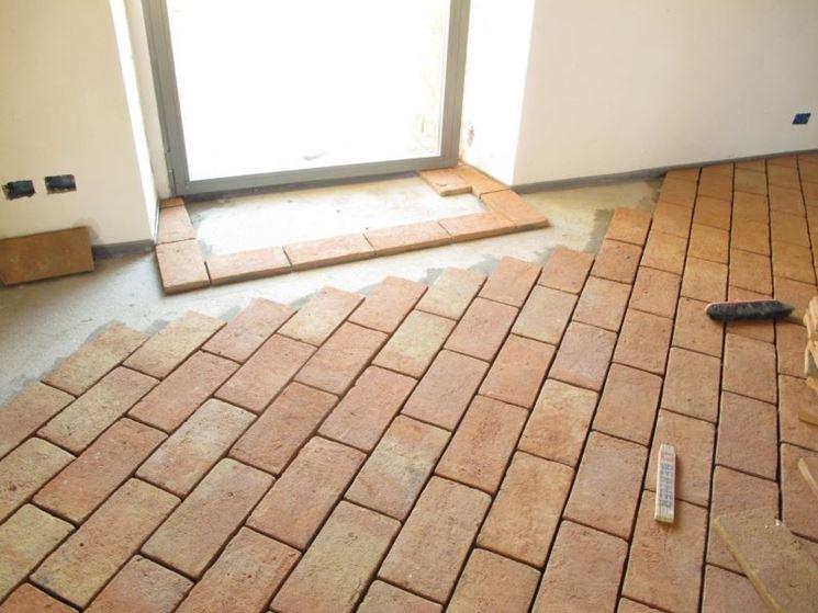 Posa in opera mattonelle tipi di mattonelle come posare le mattonelle - Posa piastrelle cucina ...