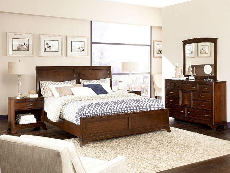 Camera da letto con mobili in legno massello