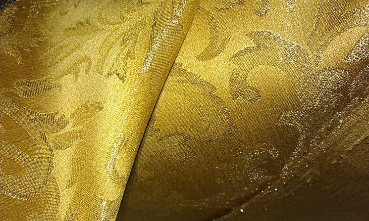 Tessuto damasco sui toni dell'oro