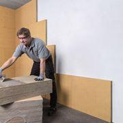 isolare rivestendo la parete