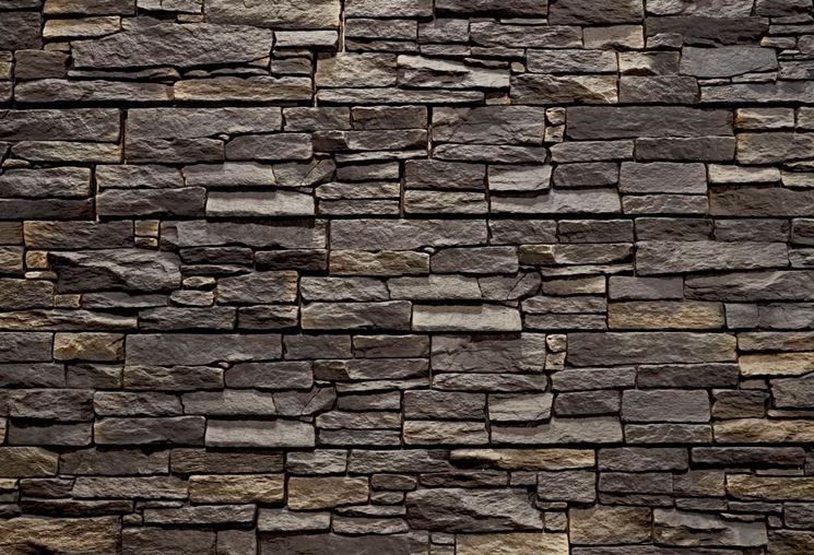 Pareti in pietra pareti e muri rivestimento pareti for Carta da parati effetto roccia